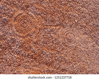 Sport shoe footprint on a tennis clay court. Dry light red crushed bricks surface on outdoor tennis ground