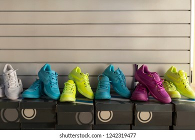 Sport shoe shop: multicolor fitness shoes in the row on their boxes for sale with a space for text writing