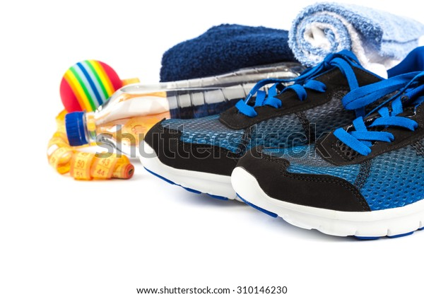 Sport shoes, equipment and measuring tape isolated on a white background.