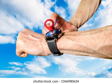 Sport smart watch with sensor location on the arm of the man against the sky