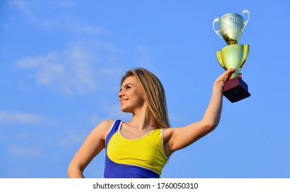 Sport success. Gold prize. Cute athlete being awarded with cup. First place award and success. girl hold a golden trophy. woman won the competition. woman winner success award. happy girl hold trophy.