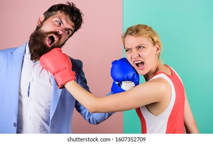 sport success. problems in relationship. sport. family couple boxing gloves. Strength and power. bearded man hipster fighting with woman. knockout punching. who is right. win the fight.