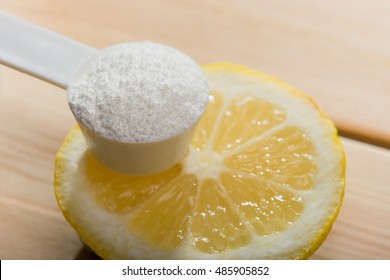 Sport supplement or vitamin with a lemon slice. Sport nutrition and health concept.
