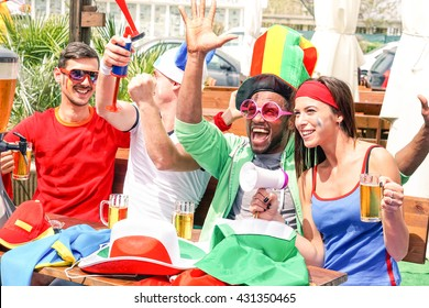 Sport supporters watching football game on tv screen at beach bar - Mixed race soccer fans cheers with beer together as best friends - Concept of fun and people friendship at sportive events -