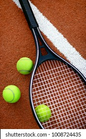 Sport. Tennis Balls And Racket On Court. Close Up Of Equipment For Sports Such As Tennis Racquet And Yellow Ball Lying On Open Court. High Quality