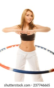 Sport training gym and lifestyle concept. Sporty girl doing exercise with hula hoop. Fitness woman isolated on white