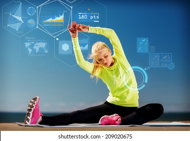 sport, training, technology and lifestyle concept - young woman exercising outdoors