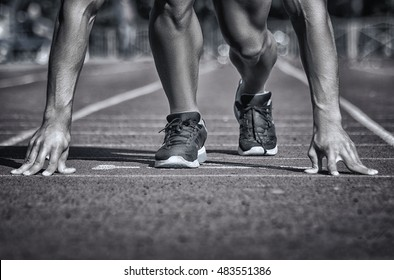 Sport. Unrecognizable runner on the starting -- selective focus, toned and stylized photo