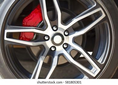 Sport vehicle disc brake and alloy wheels detail. Horizontal