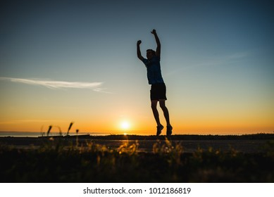Sport winner. Success happy person. Victory achievement in fitness competition. Young adult successful healthy man. Triumph, finish, win of athlete. People silhouette.