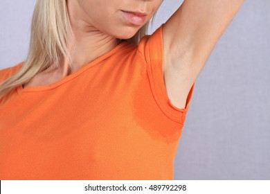 Sport woman armpit sweating. Transpiration stain. Hyperthyroidism concept