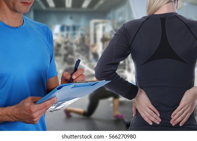 Sport Woman with Back Pain in Gym . Sports exercising injury. Rehabilitation and Exercise for Healthy Back