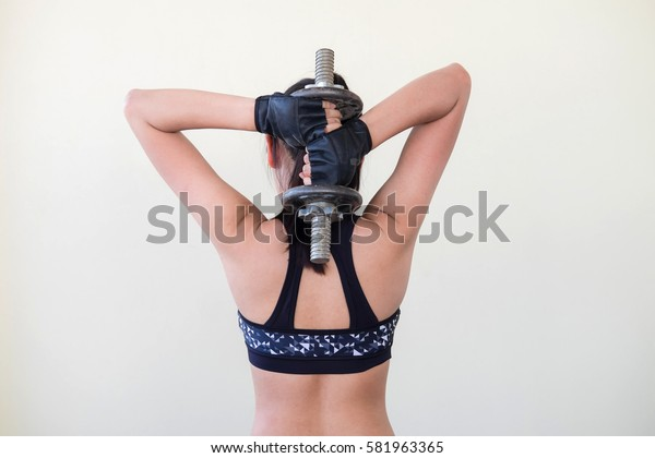 Sport. Woman sport body strong and beautiful dumbbell sport