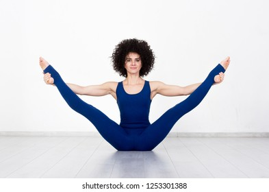 Sport woman doing stretching fitness exercise at sport gym