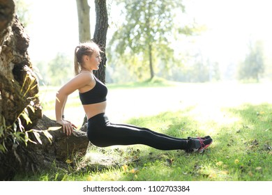 Sport. Woman exercise in the park