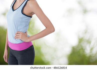 sport woman with picture of blur tree picture in background