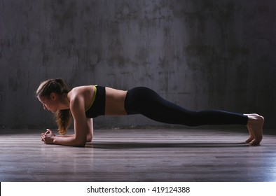 Sport woman posing in photostudio. Fitness motivation picture