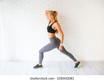 Sport woman posing in photostudio over brick wall. Fitness motivation picture
