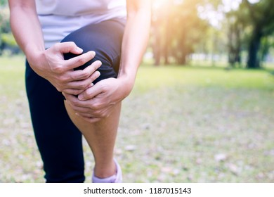 sport woman, runner has knee pain or leg injury after work out and running in park