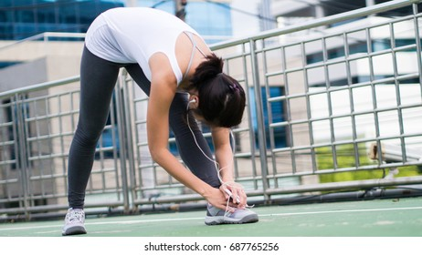 sport woman stretching running in city urban building background