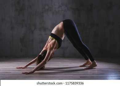 Sport woman training in dark studio