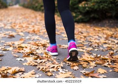 Sport woman training outside in city park. Autumn sport training outsite