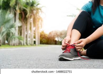sport woman tying shoelace before running, outdoor activities