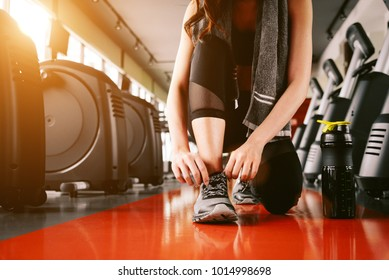 Sport woman tying sneakers rope. Sport center and Fitness gym concept. Healthy and Body build up theme. Sport wear and Fashion theme. Shoe laces tying.