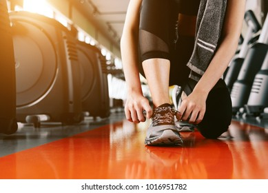 Sport woman tying sneakers rope. Sport center and Fitness gym concept. Healthy and Body build up theme. Sport wear and Fashion theme