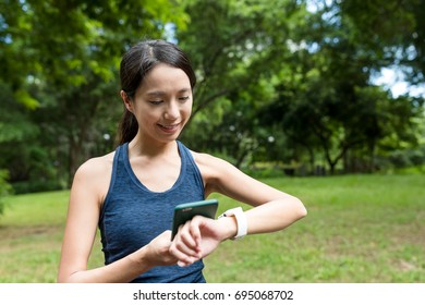 Sport woman using smart watch connect to mobile phone