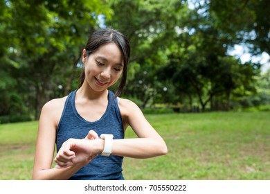 Sport woman using smart watch
