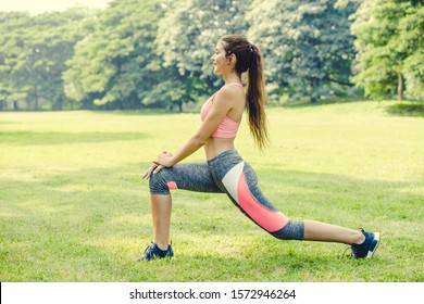 Sport women doing body warm up leg stretching muscle relax prepare for run and exercise.