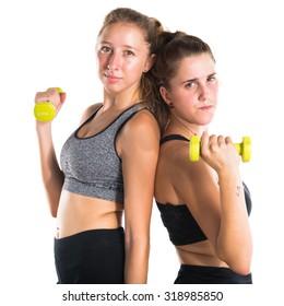 Sport women doing weightlifting