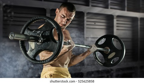 Sport, workout. Closeup portrait of a muscular man workout with barbell at gym.