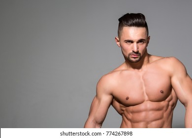 Sport and workout. Dieting and fitness. Coach sportsman with bare chest. Athletic bodybuilder man on grey background. Man with muscular body and torso, copy space