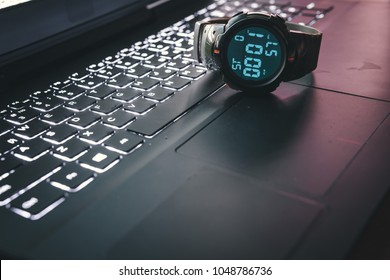 sport Wrist Watch stopwatch on black laptop keyboard in the background, millitary