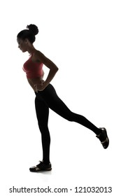 sport young athletic woman doing legs exercise, active fitness girl silhouette studio shot over white background