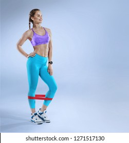Sport. Young athletic woman use fitness gum. Muscular and strong girl exercising. Fitness exercising with expander.