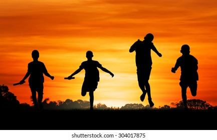 sport young boy  running  go to the winner at sunset background