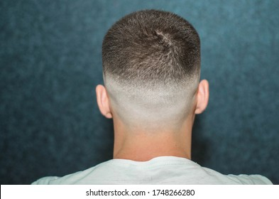 sport young man with a modern trendy fadeback haircut for barbershop.