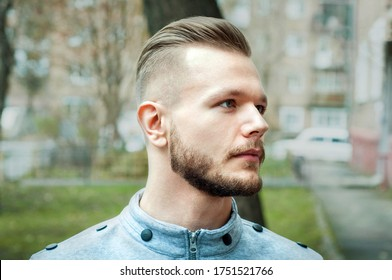 sport young man with a modern trendy fade profile haircut for barbershop.