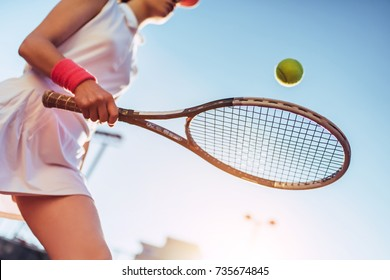 Sport young woman on tennis court. Female tennis player.