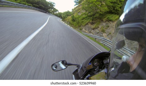 Sportbike is in turn at high speed, first-person view