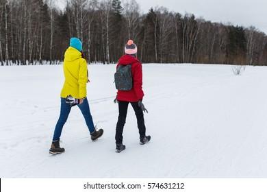Sporting girlfriend in winter woods