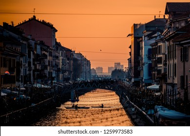 sporting people have fun with canoe at Navigli Milano Italy - winter xmas time