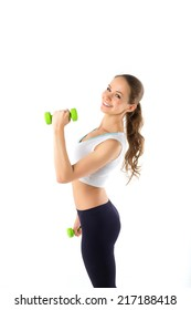 Sporting young woman is engaged with dumbbells on a white background