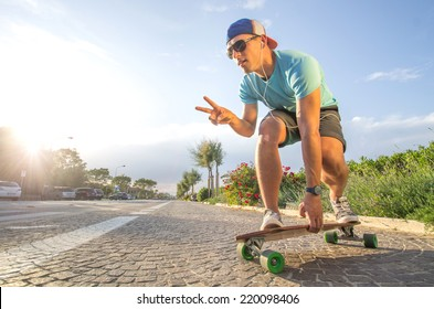 Sportive cool an on a skateboard  - cool street skateboarder in a urban setting - fashion,sport,lifestyle concept