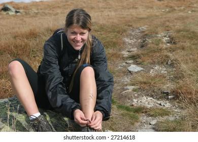 Sportive girl on the mountain trek