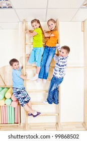 Sportive kids climbing on wall bars