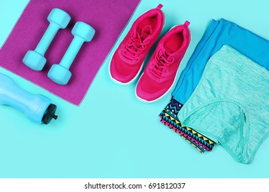 Sportive still life on teal color background top view